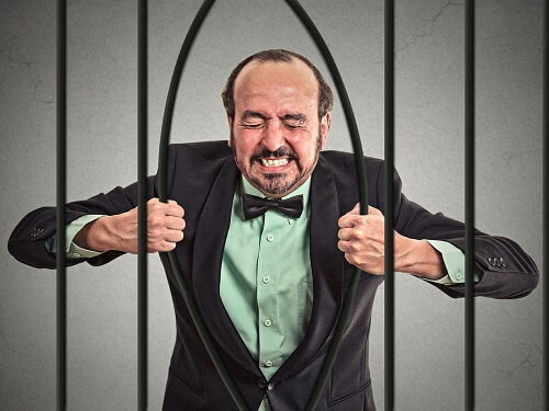 man bending prison bars with bare hands for blog post featured image