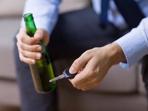 man with beer and car keys for blog post featured image